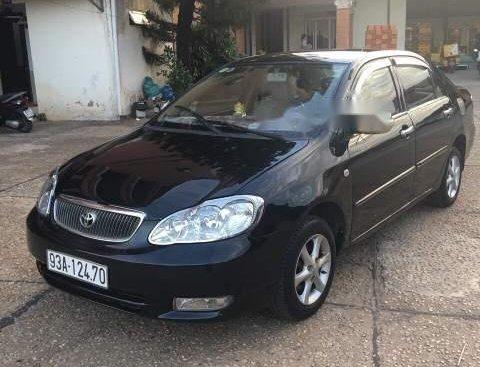 Bán xe Toyota Corolla altis MT đời 2003, màu đen, xe nhập, xe gia đình sử dụng
