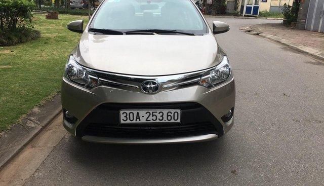 Bán Toyota Vios E năm sản xuất 2014, màu vàng, xe gia đình