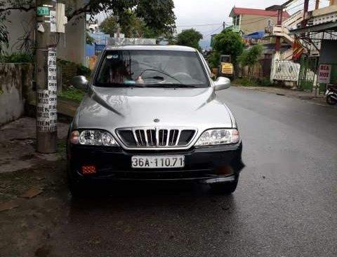 Bán xe Ssangyong Musso đời 2002, màu bạc