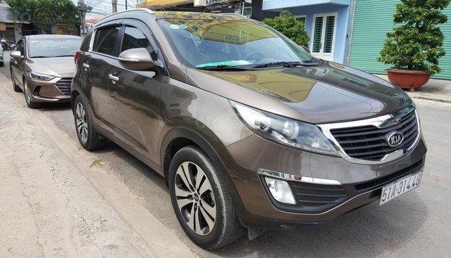Bán Kia Sportage 2.0AT màu nâu titan, số tự động, nhập Hàn Quốc 2011, biển Sài Gòn