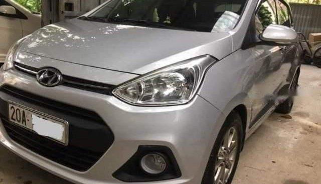 Chính chủ bán gấp Hyundai Grand i10 1.0 AT năm 2015, màu bạc, nhập khẩu nguyên chiếc