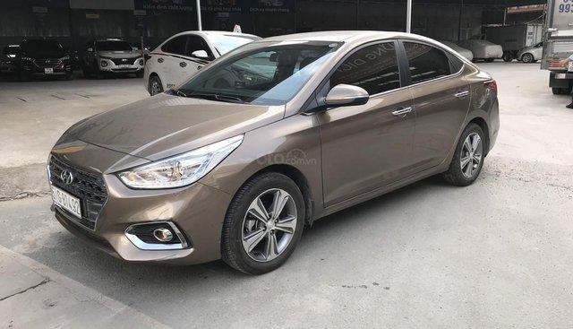 Bán Hyundai Accent 1.4AT màu nâu titan, bản đủ cao cấp sản xuất 2018 biển Sài Gòn 99%