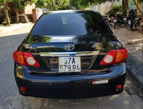Cần bán lại xe Toyota Corolla altis G đời 2010, màu đen