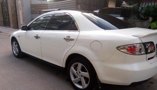 Cần bán lại xe Mazda 6 2.0 MT sản xuất năm 2004, màu trắng