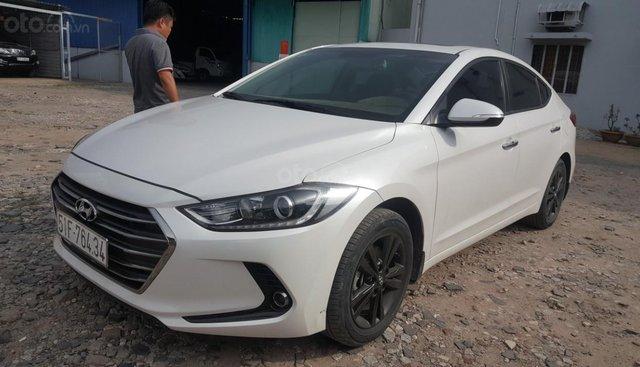 Bán Hyundai Elantra GLS 1.6AT màu trắng, số tự động sản xuất 2016, biển Sài Gòn, 1 chủ đi 26000km
