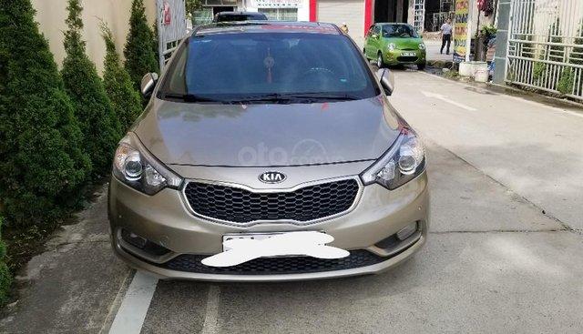 Bán Kia K3 1.6AT năm sản xuất cuối 2015, màu vàng cát