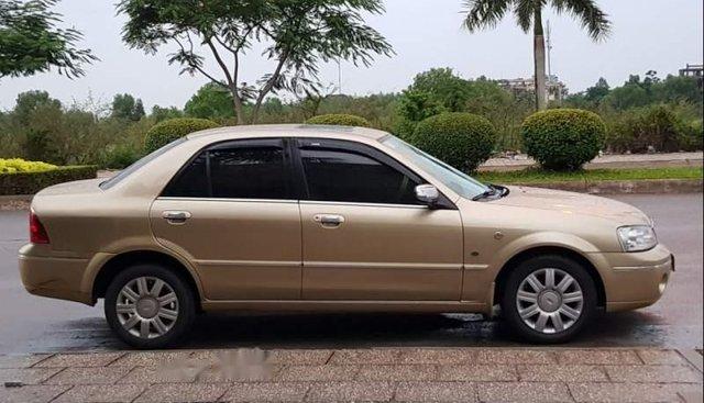 Bán ô tô Ford Laser 1.8 AT sản xuất 2003, màu vàng như mới