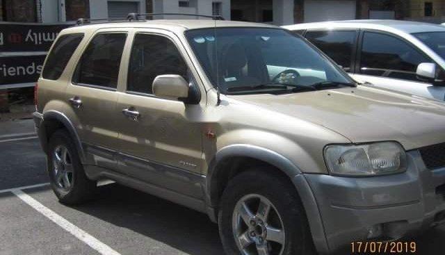 Cần bán xe Ford Escape 3.0 V6 sản xuất 2002, màu vàng, giá chỉ 138 triệu