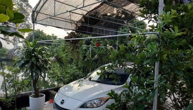Cần bán xe Mazda 3 1.6AT sản xuất 2012, màu trắng