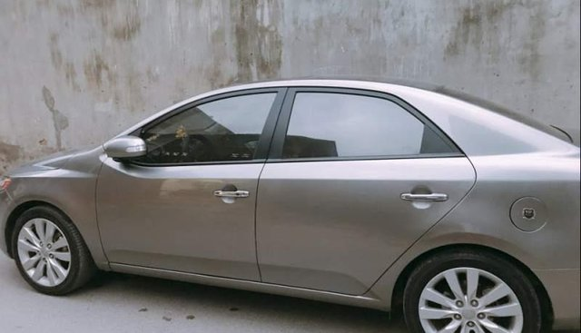 Bán Kia Forte SX 2009, màu vàng, nhập khẩu, full options