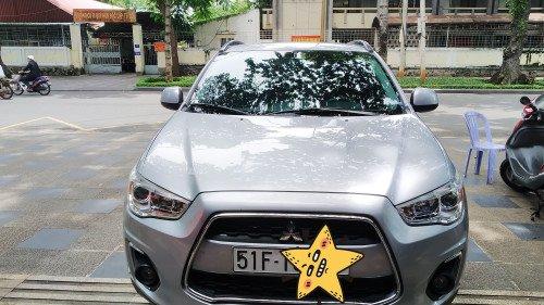 Cần bán gấp Mitsubishi Outlander Sport 2.0 AT sản xuất 2015, màu bạc, xe nhập