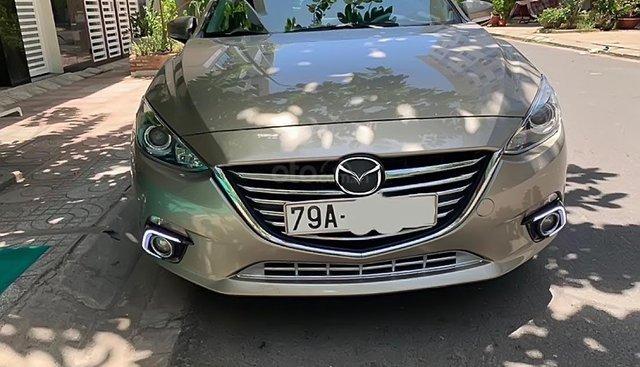 Cần bán xe Mazda 3 đời 2016, màu vàng, bao đâm đụng, không bị ngập lụt
