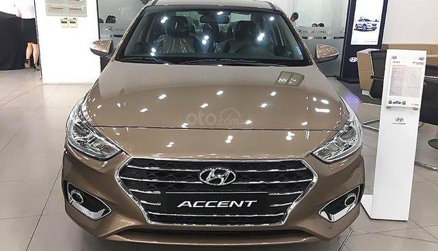 Bán xe Hyundai Accent 1.4 MT năm 2018, màu vàng cát