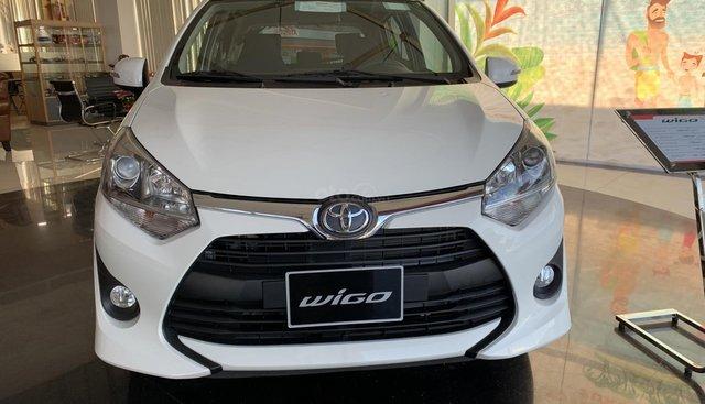 Bán Toyota Wigo 1.2 AT 2019 nhập khẩu, màu trắng, giá 390tr hỗ trợ trả góp. LH: 0943.134.210