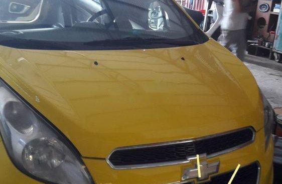 Bán xe Chevrolet Spark sản xuất 2015, màu vàng, nhập khẩu