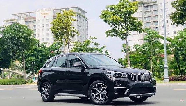 Bán xe BMW X1 18i Xline sản xuất năm 2019, màu đen, xe nhập