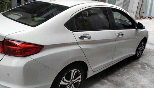 Honda City AT đời 2014, màu trắng, biển số TpHCM 9 nút