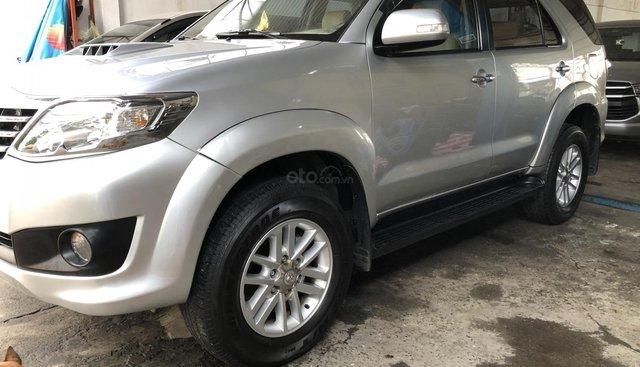 Bán Toyota Fortuner G sản xuất năm 2014, màu bạc, gia đình sử dụng kỹ