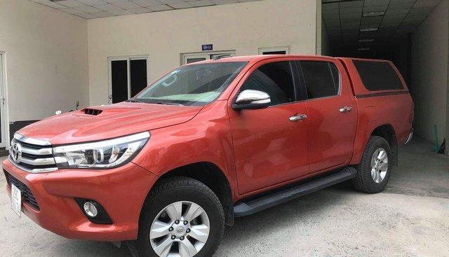 Bán ô tô Toyota Hilux năm sản xuất 2016, màu đỏ, giá chỉ 660 triệu