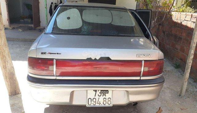 Cần bán xe Mazda 323 1.6MT đời 1995, màu bạc, nội thất đẹp chính chủ