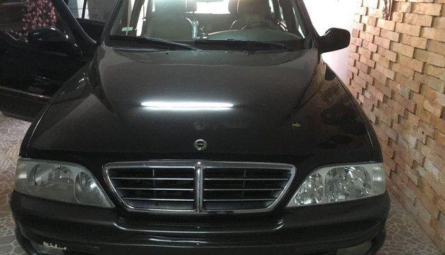 Bán lại xe Ssangyong Musso đời 2004, màu đen, nhập khẩu