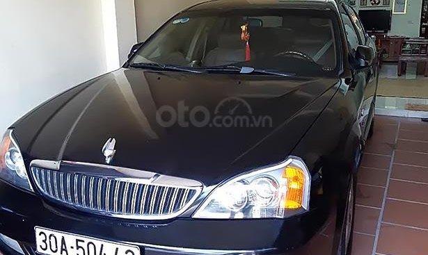 Cần bán gấp Daewoo Magnus đời 2004, màu đen