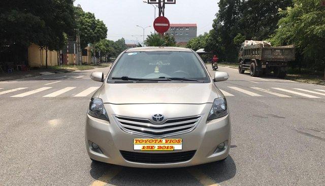 Bán ô tô Toyota Vios 1.5E sản xuất 2013, màu vàng, xe cực tuyển, cam kết chất lượng