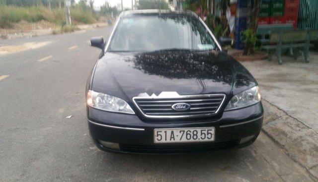 Cần bán lại xe Ford Mondeo đời 2003, màu đen, còn mới, giá 110tr