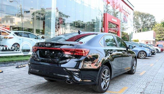 Bán xe Kia Cerato Deluxe sản xuất năm 2019, màu đen giá cạnh tranh