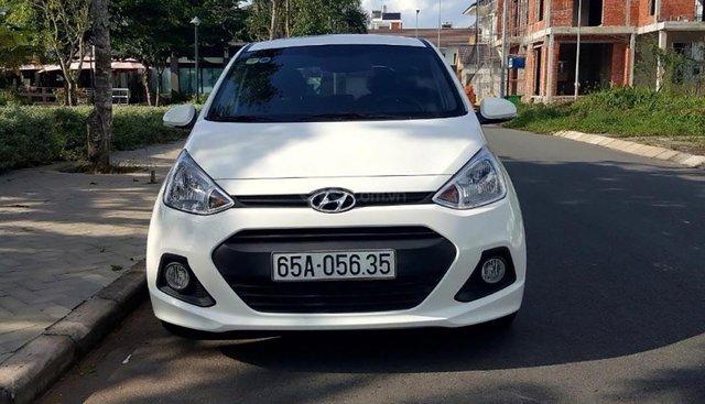 Cần bán gấp Hyundai Grand i10 1.0 MT đời 2014, màu trắng, nhập khẩu nguyên chiếc chính chủ