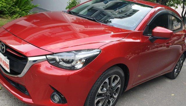 Bán Mazda 2 Hatchback 1.5 số tự động model 2016 SX T12 /2015 màu đỏ, nhập khẩu đẹp mới 90%