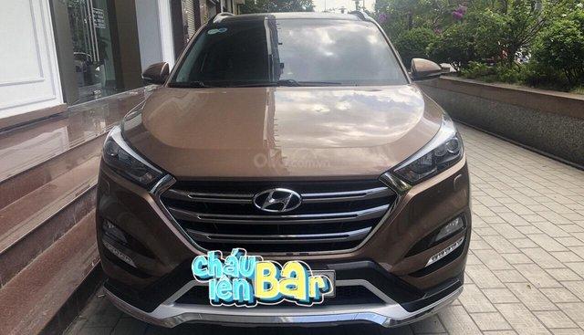 Cần bán xe Hyundai Tucson GLS 2.0 AT FWD sản xuất 2015, màu nâu, nhập khẩu nguyên chiếc, 778tr