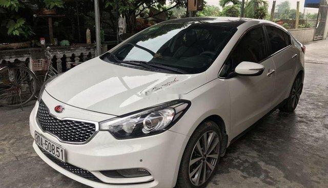 Cần bán Kia K3 AT năm 2014, màu trắng