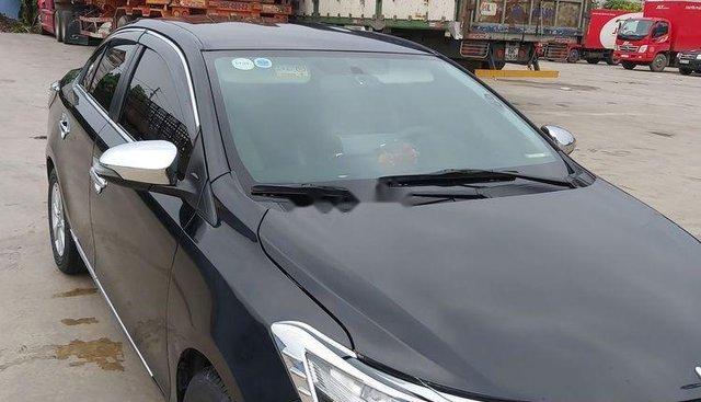 Bán Toyota Vios đời 2014, màu đen số sàn