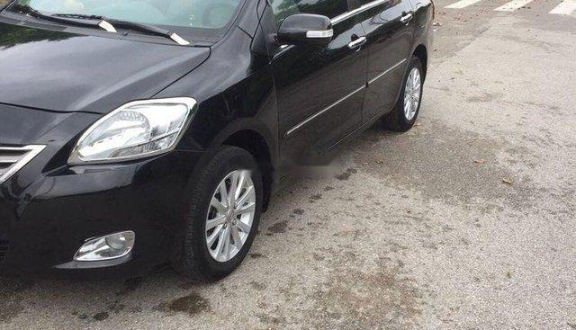 Gia đình bán xe Toyota Vios 1.5 E sản xuất 2011, màu đen