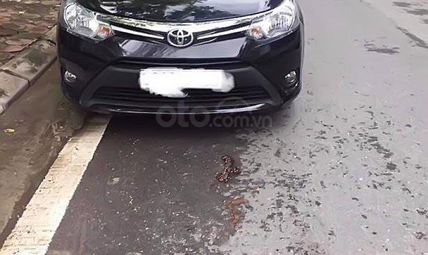 Bán Toyota Vios 1.5E đời 2014, màu đen số sàn