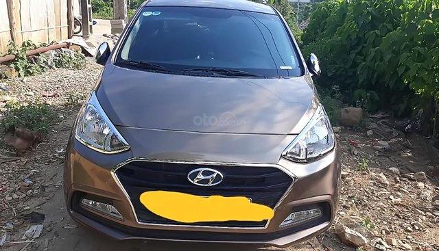 Bán Hyundai Grand i10 sản xuất năm 2018, màu vàng cát