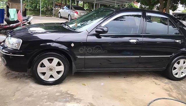 Bán Ford Laser GHIA 1.8 MT 2003, màu đen, chính chủ
