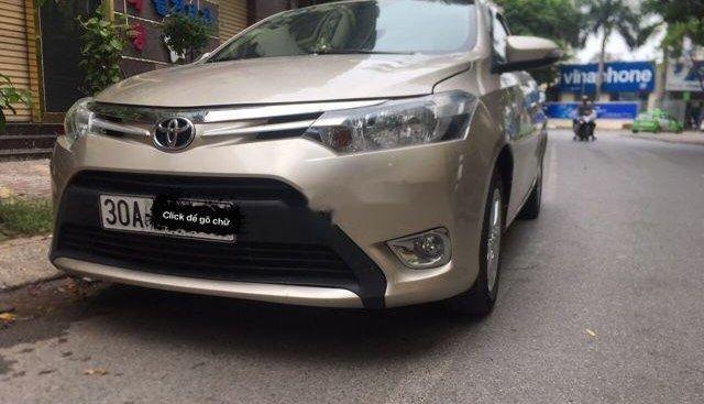 Bán Toyota Vios E đời 2014, màu vàng, chính chủ