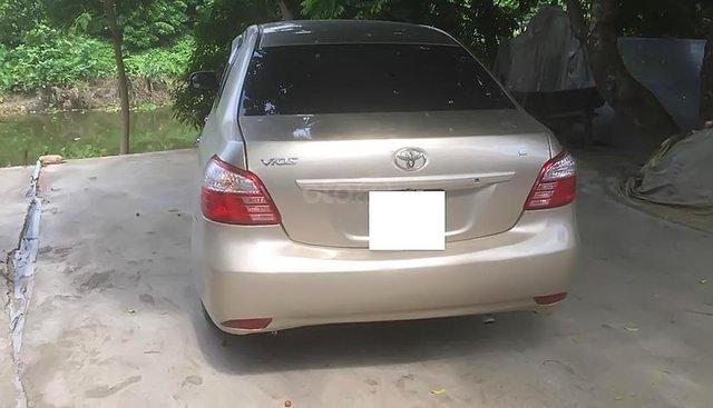 Bán Toyota Vios năm sản xuất 2010, màu vàng cát