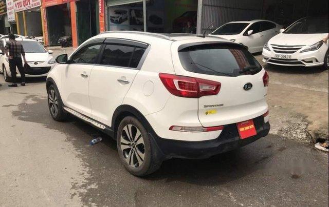 Cần bán xe Kia Sportage sản xuất năm 2011, màu trắng, nhập khẩu nguyên chiếc, giá chỉ 585 triệu1