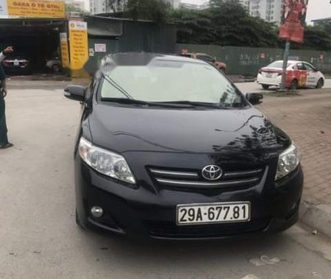 Bán Toyota Corolla Altis đời 2009, màu đen còn mới0