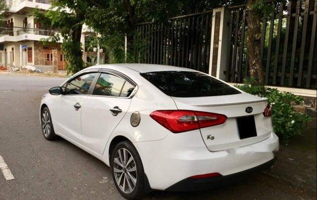 Cần bán lại xe Kia K3 2014, màu trắng còn mới, 419 triệu1