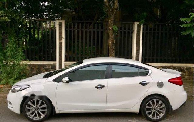 Cần bán lại xe Kia K3 2014, màu trắng còn mới, 419 triệu2