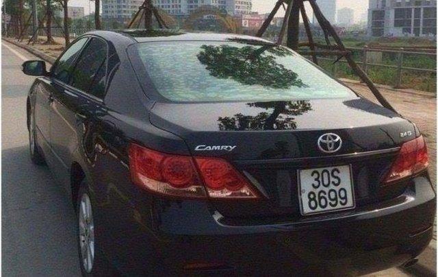Cần bán xe Toyota Camry 2.4G đời 2010, màu đen, nội thất kem