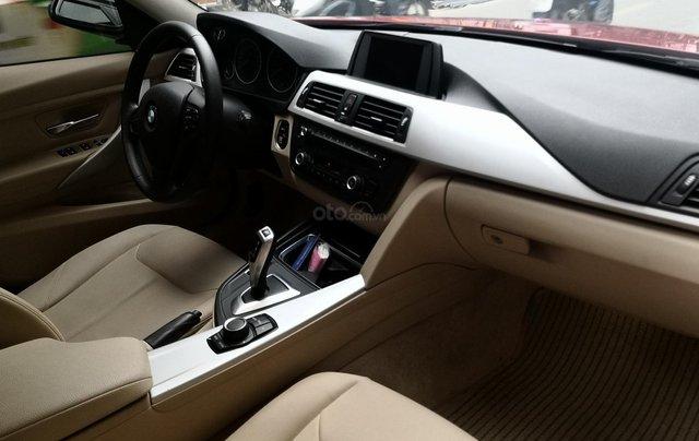 Cần bán xe BMW 320i sản xuất 2012 màu đỏ4
