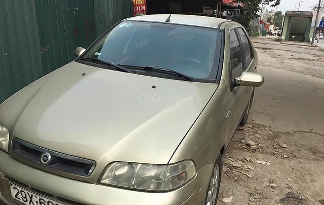 Cần bán xe Fiat Albea HLX đời 2005, màu vàng0
