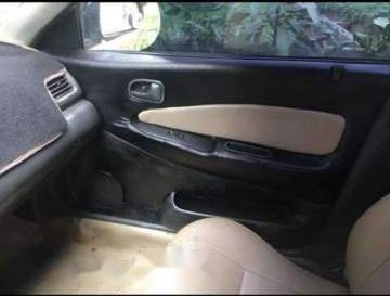 Cần bán Mazda 323 đời 2001, màu đen, xe nhập, 78tr2