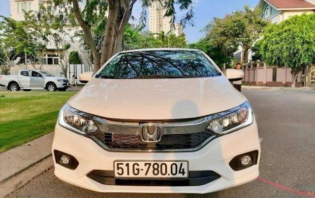 Cần bán gấp Honda City 1.5 Top sản xuất năm 2019, màu trắng như mới0