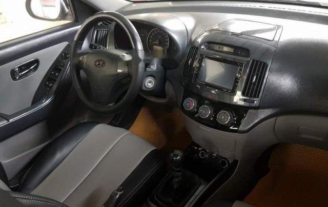 Bán Hyundai Avante đời 2015, màu trắng số sàn3